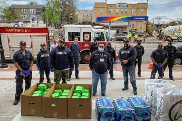 Greater Hartford Harm Reduction Coalition with Hartford Fire Department Distributing Supplies for Covid